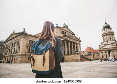 Tourist girl with a backpack or a student looks at the sights in Berlin in Germany.