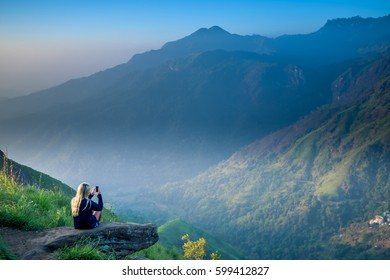 Tourist girl at beautiful landscape in Little Adams's peak, Ella, Srilanka