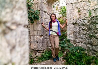tourist girl looks at Anakopia fortress from the wall of an ancient castle, Abkhazia