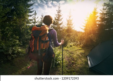 tourist girl stands near the tent in the  mountain. Carpathians,  Ukraine.