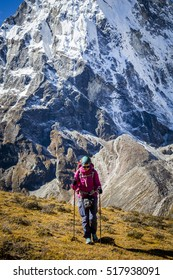 A tourist girl trekking in Himalayas to Everest Base Camp