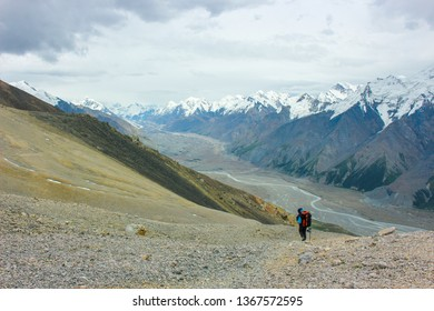 Tourist goes down to the valley from the pass