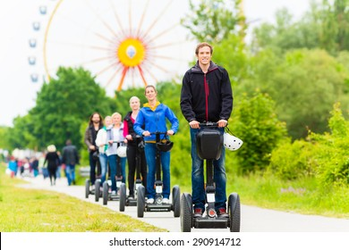 Tourist group having guided Segway theme park tour