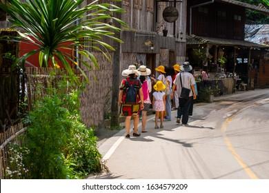 Tourist group walking at Mae Kam pong market in Chiangmai city thailand