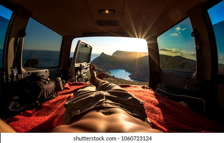 tourist has a rest in the car on beauty nature landscape. Concept car traveling and camping.