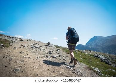 tourist hiking on Besseggen ridge in Jotunheimen National Park, Norway