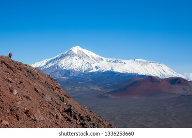 A tourist hiking at the top of the mountain  of the landscape of volcanoes Tolbachik. Kamchatka. Russia