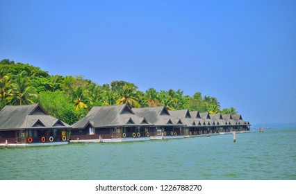 Tourist houses on the banks of Ashtamudi lake in Kollam, Kerala.