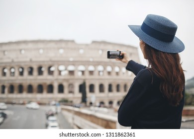 tourist in Italy, Rome. Woman doing self portrait with architecture in Europe