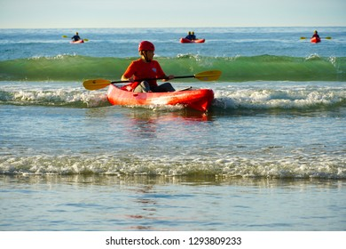 Tourist kayaking in La Jolla beach, San Diego, California, USA.  Red kayak and canoe in the sea for un family or friend activity. Travel  and activity concept. 01/07/2019