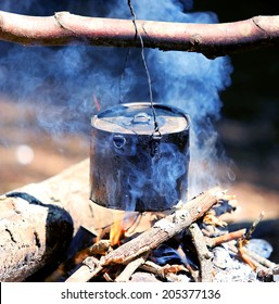 tourist kettle over campfire with blue smoke