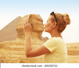 Tourist kissing the Sphinx, Cairo, Egypt. Kiss of the Sphinx. Young Blonde Woman in Giza