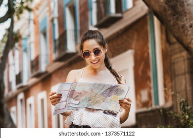 tourist latin girl with map, travel, leisure, holidays in a Hispanic and colonial city in Mexico