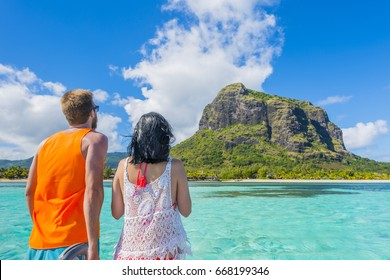 Tourist at Le Morne Brabant - Mauritius Tropical Island beach and mountain