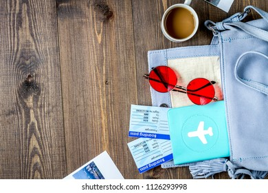 tourist lifestyle with tickets and passport wooden table backgro