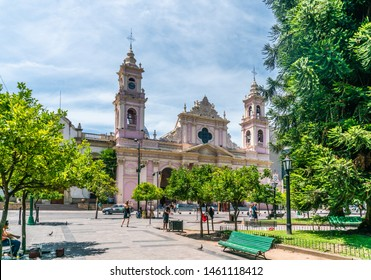 Tourist and locals passing the Catedral Basilica de Salta at the city park 'Plaza 9 de Julio' square July the 9th, Salta, Argentina - February 3th 2019