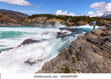 Tourist looking at the Confluence of the Baker and Nef rivers, Carretera Austral, Chile Patagonia