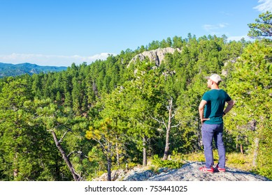 Tourist looking at the landscape in Custer State Park in South Dakota