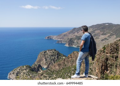 Tourist looking at sea bays in historical and archeologyl Antiochia ad Cragum site