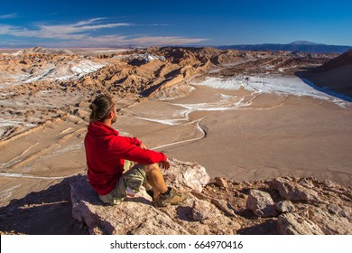 A tourist looks at Moon Valley in the Atacama Desert, Chile.