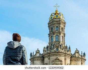 A tourist looks at the Znamenskaya church (Church of Our Lady of the Sign) in Dubrovitsy