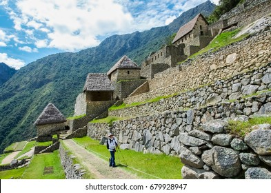 Tourist in Machu Picchu, the Lost City of the Incas, Peru
