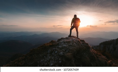Tourist man hiker on top of the mountain. Active life concept