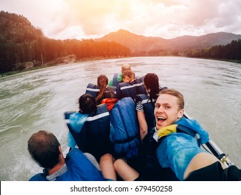 tourist man sitting in boat and happy with motor rides at high speed along river. Concept rafting