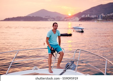 tourist man travel on yacht at sunset. Man with camera at sunset seascape