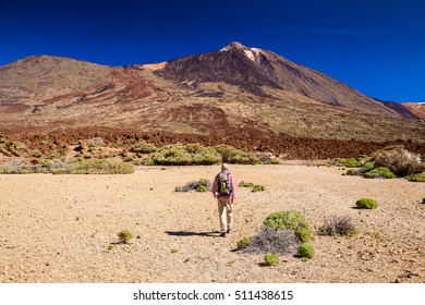tourist man treking through Las Canadas National park, Pico del Teide, Tenerife, Spain