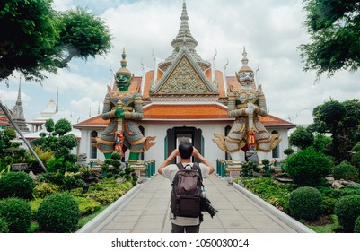 The tourist man visiting Wat Arun Ratchawararam Ratchawaramahawihan (Temple of Dawn) Main pagoda after renovation in 2017 Wat Arun, locally known as Wat Chaeng, is situated on the west (Thonburi) bank