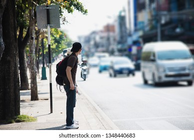 Tourist man waiting for crossing the road in Chiang mai City, Thailand - Asian travel tourist people in city concept