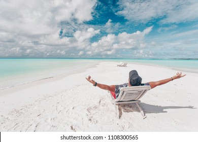 tourist man who enjoys a view on the island Zanzibar against the background of the beauty of the sea with coral reefs.