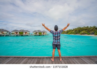 Tourist man who enjoys a view on the island of  against the background of the beauty of the sea with coral reefs.