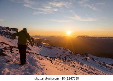 Tourist meets the sunset in the French Alps. Scenic image of hiking concept. Perfect moment in alpine highlands. Location Mont Blanc, France.