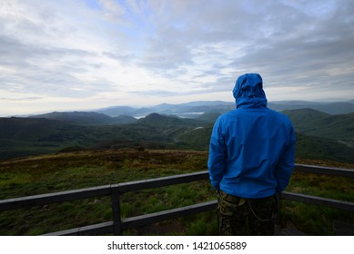 tourist in mountain looking at beautiful view