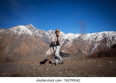 Tourist in the mountains. Kazbegi, georgia.