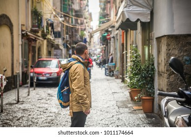 Tourist in Naples walking along the crowded, busy streets, Italy