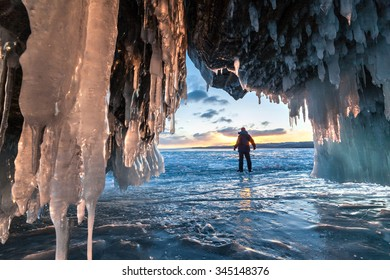 Tourist near the ice cave and across sunrise.