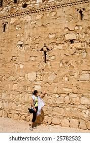 Tourist near Qasr al Kharanah, Jordan