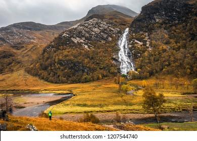 Tourist near Steall Falls in Glen Nevis, Scotland
