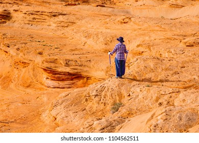 Tourist is observing beauity of red rock landscape at Glen Canyon the Chains area near city of Page, Arizona, USA