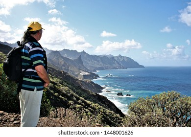 tourist observing the landscape of the area of Taganana and the Draguillo in the North of Tenerife, Canary Islands, Spain,