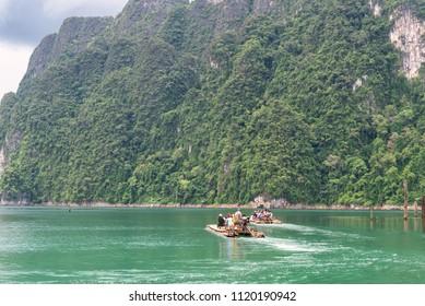 Tourist on bamboo raft. Khao Sok National Park, Ratchaprapa Dam, Surat Thani, Thailand.