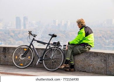 tourist on a bicycle looking at the city of Kiev ukraine 10.10.2017