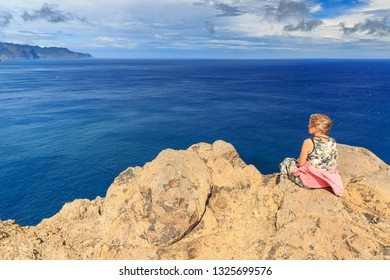 Tourist on the cliffs in the beautiful landscape of the east coast of the island Madeira at Ponta de Sao Lourenco nature reserve