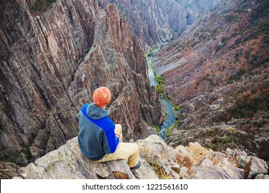 Tourist on the granite cliffs of the Black Canyon of the Gunnison, Colorado, USA
