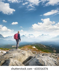 Tourist on the mountain top. Sport and active life concept in the summer time