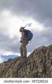 Tourist on the rocks in mountain