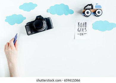 tourist outfit and camera for trip with kids white background top view mockup